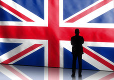 British Politician with Arms Crossed. Silhouette of a british politician with arms crossed on flag background Stock Photos