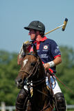 British Polo Day in Moscow. Tseleevo, Moscow region, Russia - July 26, 2014: Unidentified player of British schools with mallet in the match against Moscow Polo Royalty Free Stock Image