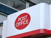 Post office sign logo UK. British Post Office red and white sign logo royalty free stock photos