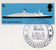 British Postage Stamp Commemorating the QE2`s Maiden Voyage in 1. UNITED KINGDOM - CIRCA 1969: A used British postage stamp celebrating the Maiden Voyage of the Royalty Free Stock Photos