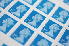British Postage Stamps. Sheet of British second class postage stamps shot with narrow selective focus Royalty Free Stock Photos