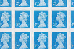 British Postage Stamps. Sheet of British second class postage stamps top down view stock images