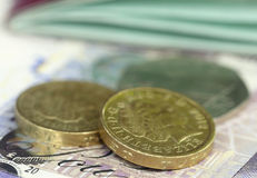 British Pound with bank notes Royalty Free Stock Photography