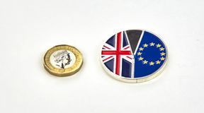 British pound and Brexit coins. MONTREAL, CANADA - MARCH 20, 2018: British pound and Brexit coins isolated on white background stock photo