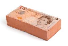 British Pound brick. Brick with a British Pound bank note imprint Royalty Free Stock Images