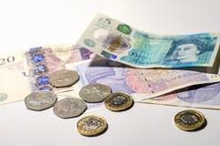 British pound coin on British pound banknotes. British pound coin placed on British pound banknotes Royalty Free Stock Photo