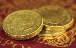 British Pound coin on passport. Close up of British Pound coin on passport Royalty Free Stock Image
