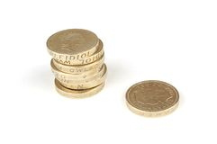British pound coins. Stack of British pound coins with single one separate, isolated on white background Royalty Free Stock Photography