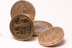 British pound coins. Pound coins isolated on white Royalty Free Stock Photography