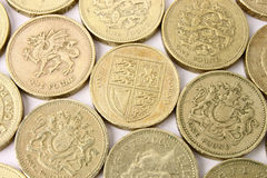 British Pound Coins. A background of rows of One Pound Sterling coins Stock Photography