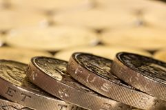 British pound coins on a background of more money. Stock Photo