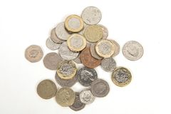 British pound coins. Variety of British pound coins on a white background stock photo
