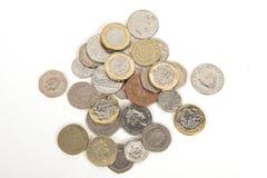 British pound coins. Variety of British pound coins on a white background Stock Photo
