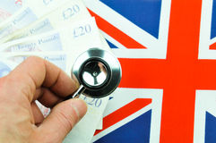 British pound concept. With currency, stethoscope and UK flag Royalty Free Stock Photos