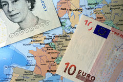 British Pound and Euro notes on European map Stock Photography