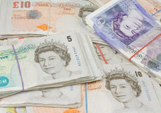 British pound notes. Bungle of british pound notes in elastic bands holding them together Stock Photo