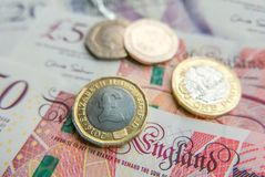 British pound notes and coins financial background close up stock photos