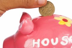British pound in piggy bank Stock Images
