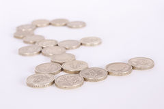 British Pound Sign in Pound Coins. Pound symbol made from gold pound coins on a white background with shallow depth of field Stock Photo