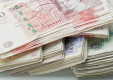 British Pound Sterling. A bundle of British Pound Sterling including fifty pound notes, twenty pound notes, ten pound notes and five pound notes Stock Image