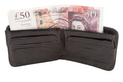 British pound sterling banknote and wallet. British pound sterling banknote inside wallet Royalty Free Stock Photo