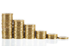 British Pound Sterling coins in decreasing heights Royalty Free Stock Photography
