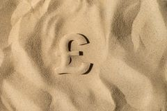 British Pound Under the Sand stock photography
