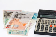 British Pounds. And a calculator on a white background Royalty Free Stock Photo