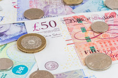 British pounds banknotes and coins background Royalty Free Stock Photography