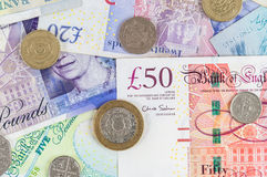 British pounds banknotes and coins background Stock Photo