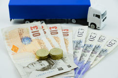 British pounds and big truck Stock Photos