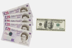 British pounds and dollars. Five twenty-pound notes and a one-hundred dollar bill (isolated on white Stock Images