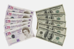 British pounds and dollars. Twenty-pound notes and one-hundred dollar bills (isolated on white Stock Photo