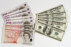 British pounds and dollars. Twenty-pound notes, fifty-pound notes and one-hundred dollar bills Royalty Free Stock Photo