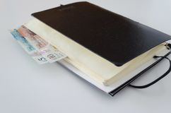 British pounds in the notebook stock images