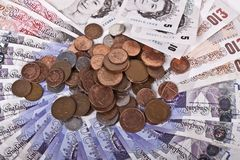 British pounds notes and coins. Royalty Free Stock Images