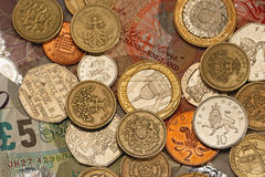 British pounds. British pound sterling coins and paper money royalty free stock images