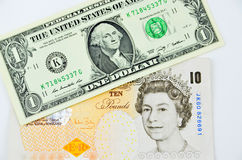 British pounds and us dollars banknotes. Lie on each other Royalty Free Stock Photo