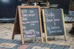 British Pub blackboard signs. In British town Royalty Free Stock Photos