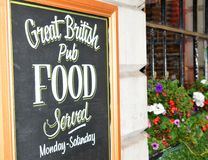 British pub. Close up of British pub sign board royalty free stock images