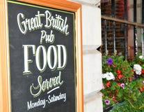British pub. Close up of British pub sign board Royalty Free Stock Images