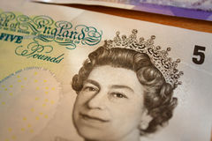 British queen on 5 british pounds-bank note stock image