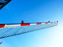 Railroad gate in morning sun. British railway gate at an angle set against a blue sky with morning sunlight royalty free stock images
