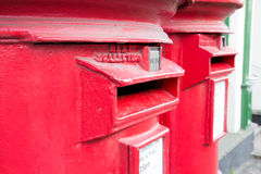 British red mail boxes. Closeup of two traditional British red mail boxes royalty free stock photo