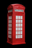 British Red Phone booth. Old British red phone booth isolated on black Stock Photography