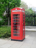 The British red phone booth. With city background Stock Photo