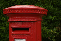 British red post box. A traditional red british post box stock images