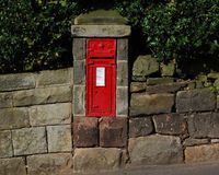 British red post box on wall Royalty Free Stock Photo