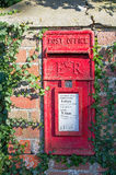British Red Postbox set in wall Stock Image