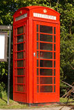 British Red telephone booth. Traditional Red phone booth next to the village notice board in a typical English village Royalty Free Stock Photo